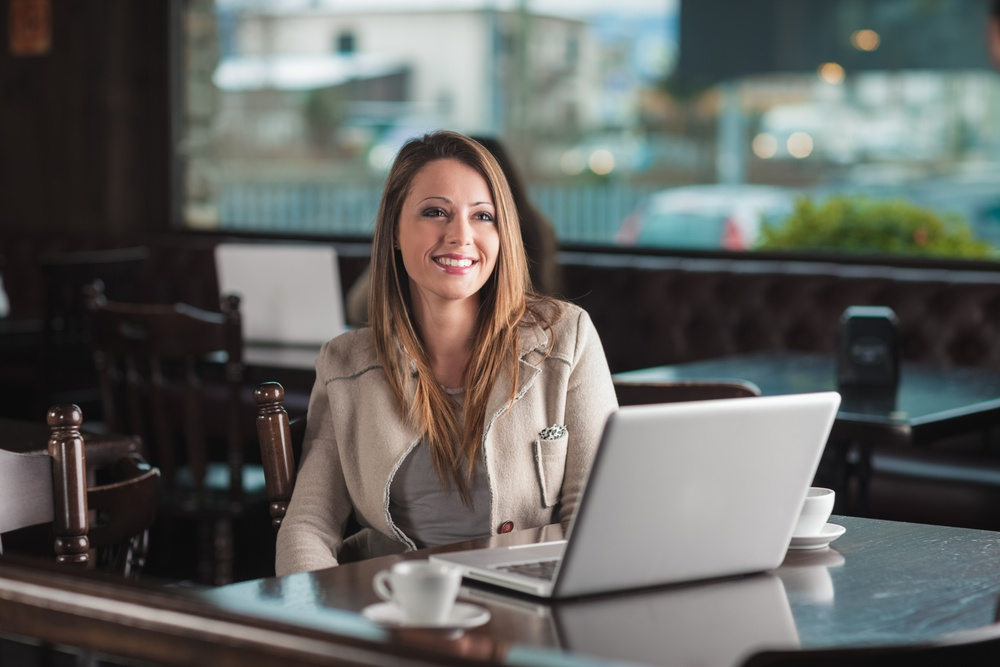 Woman writing her brand story